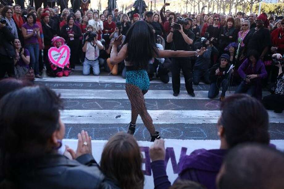 Drag queen supermodel Acid Fierce performs during a One Billion Rising event at City Hall.
