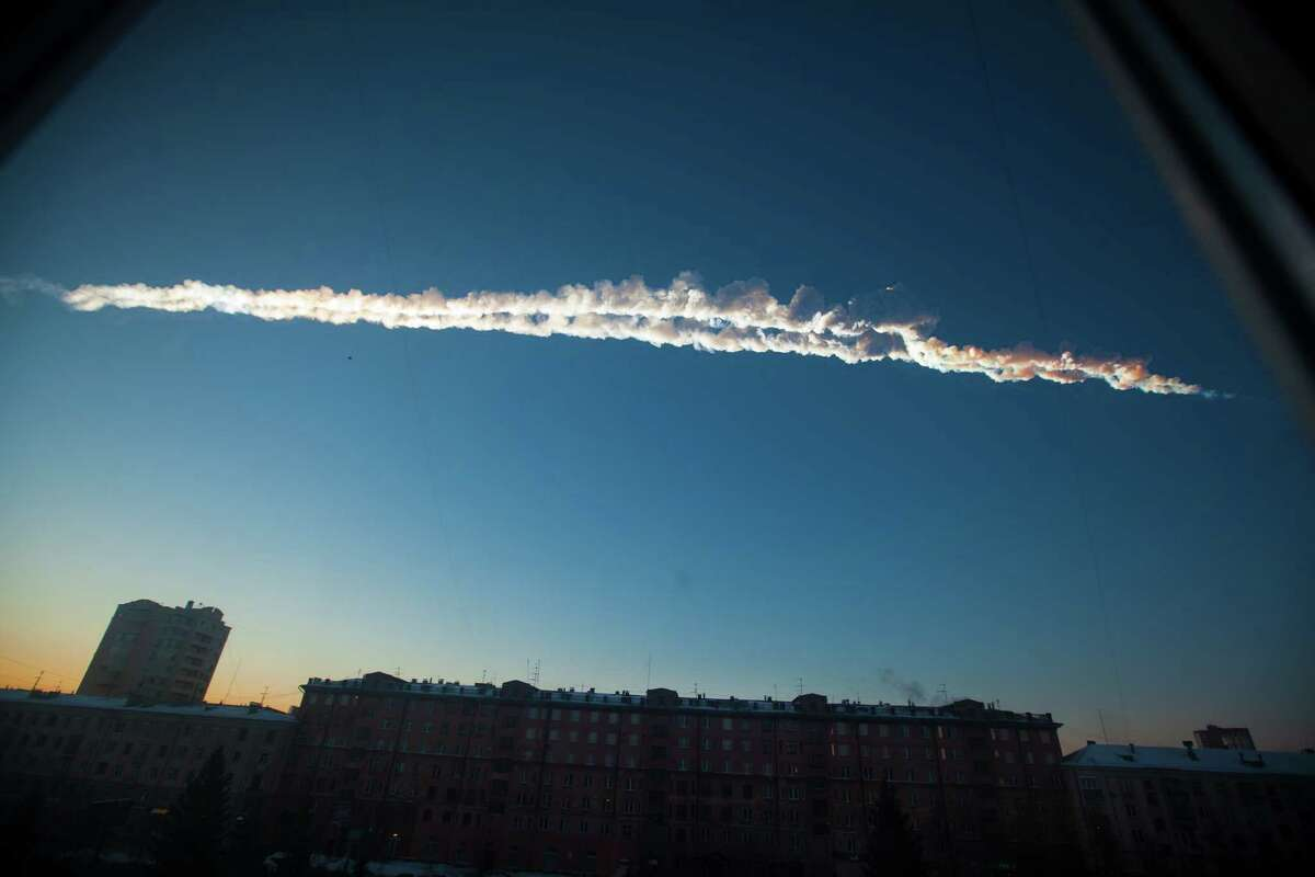 In this photo provided by Chelyabinsk.ru a meteorite contrail is seen over Chelyabinsk on Friday. A meteor streaked across the sky of Russia's Ural Mountains on Friday morning, causing sharp explosions and reportedly injuring more than 1,100, including many hurt by broken glass. (AP Photo/Chelyabinsk.ru)