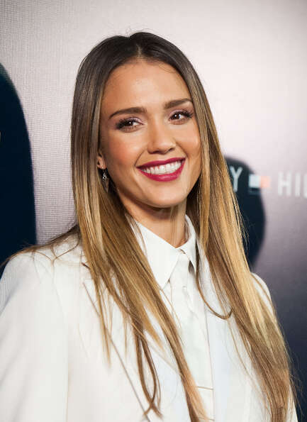 Jessica Alba arrives at the Tommy Hilfiger LA Flagship Opening on February 13, 2013 in Los Angeles,