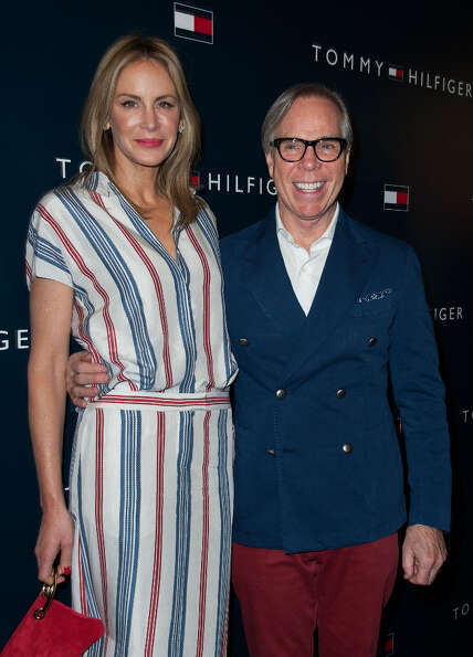 Dee Hilfiger and Tommy Hilfiger arrive at the Tommy Hilfiger LA Flagship Opening on February 13, 201