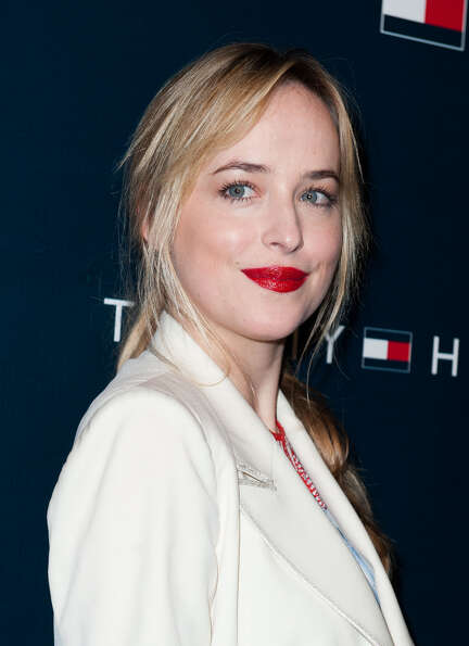 Dakota Johnson arrives at the Tommy Hilfiger LA Flagship Opening on February 13, 2013 in Los Angeles