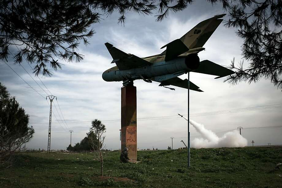 A rocket fired by Syrian rebels looks like it might be targeting a low-flying jet, but it's really heading toward regime forces stationed at Kwiriss airport in Al-Babb. Photo: Elias Edouard, AFP/Getty Images