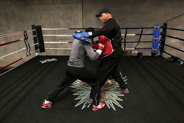 "Boxing trainer Virgil Hunter (right) works with fighter Fernando Guerrero at Hunter's gym in Hayward. Hunter has been called the ""Zen master of boxing."" Photo: Michael Macor, The Chronicle"
