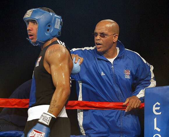 Andre Ward (left), former Olympic gold medalist and current super middleweight champion from Oakland, is the godson and prize pupil of boxing trainer Hunter (right). Photo: Frederic Larson, SFC