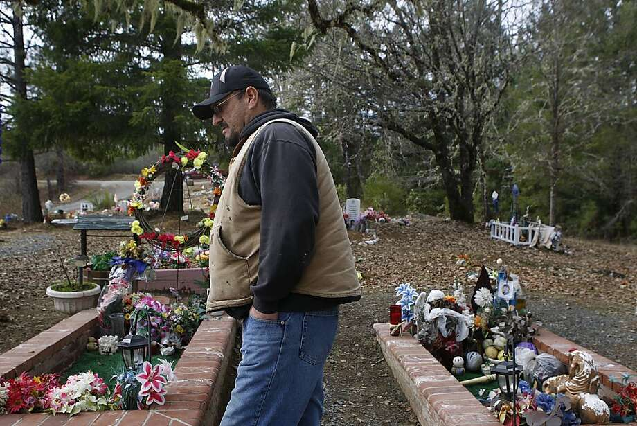 Trent Campbell visits the graves of his wife and son at the Cahto reservation cemetery in Laytonville. His son, Aaron, fatally shot himself at his mother's grave at age 19 after she died of a heart attack. Photo: Liz Hafalia, The Chronicle