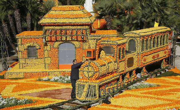 Fruit 'n' tootin': A worker puts the finale touches on a train adorned with lemons and oranges during the 80th Lemon Festival in Menton, France. Photo: Lionel Cironneau, Associated Press