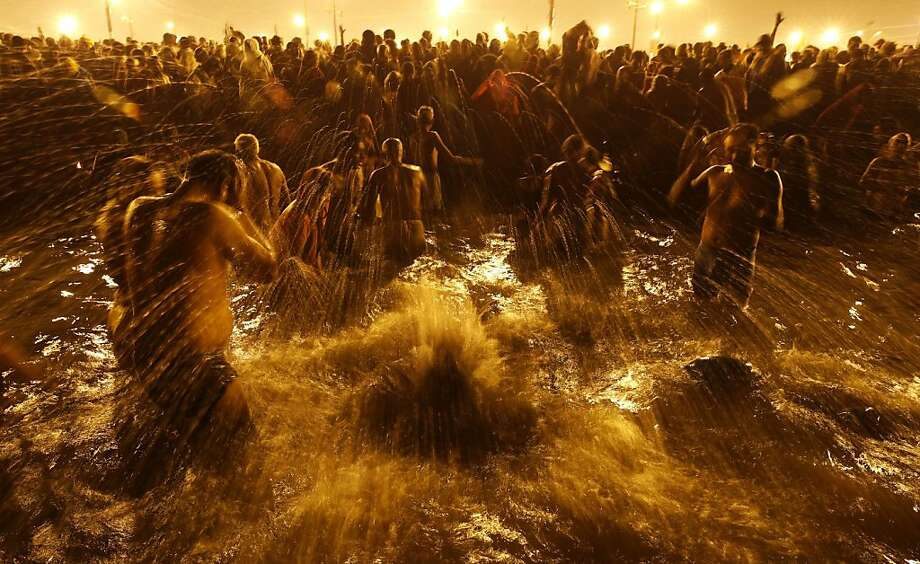 Hindu devotees take ritual dips at 'Sangam', confluence of Hindu holy rivers of Ganges, Yamuna and the mythical Saraswati, on the third and last royal bath of the Maha Kumbh festival on occasion of 'Basant Panchami' in Allahabad, India, Friday, Feb. 15, 2013. Millions of Hindu pilgrims are attending the Maha Kumbh festival, which is one of the world's largest religious gatherings that lasts 55 days and falls every 12 years. During the festival pilgrims bathe in the holy Ganges River in a ritual they believe can wash away their sins.  Photo: Saurabh Das, Associated Press