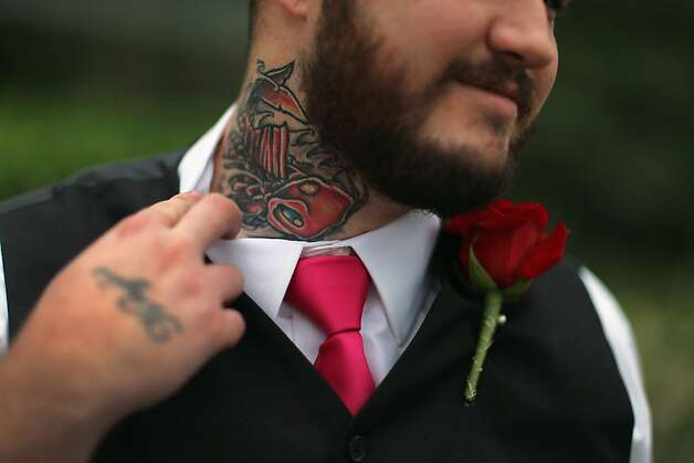Buried at sea: Robert Homa had a girlfriend's name tattooed on his neck, but unfortunately it wasn't the name of the woman he's marrying in West Palm Beach, Fla. So he had the name inked over with this nautical-themed design. Photo: Joe Raedle, Getty Images