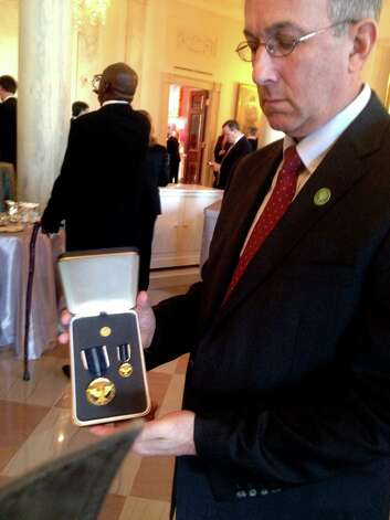 Michael Murphy with the 2012 Presidential Citizens Medal that President Obama presented to the late Anne Marie Murphy, killed at Sandy Hook Elementary School in Newtown, Conn. on Dec. 14, 2012. Photo: Contributed Photo\Charles J. Lew, Contributed Photo / Connecticut Post Contributed