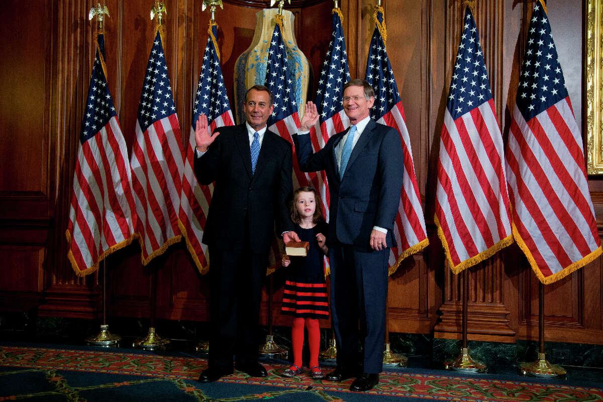 House Speaker John Boehner of Ohio performs a mock swearing in for Rep. Lamar Smith, R-Texas, Thursday, Jan. 3, 2013, on Capitol Hill in Washington as the 113th Congress began. (AP Photo/ Evan Vucci)