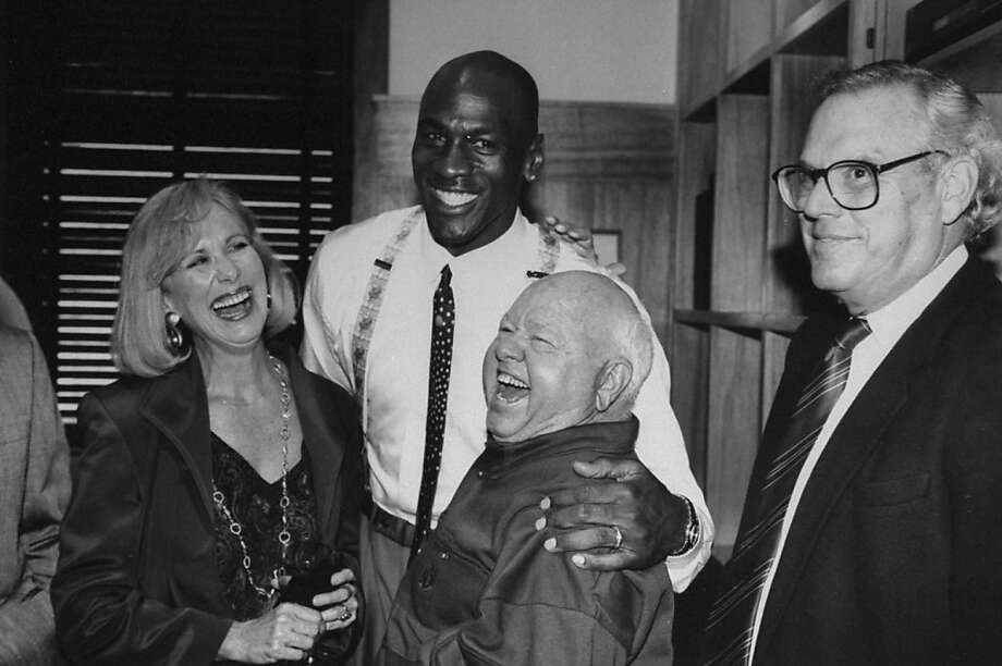 Chicago Bulls basketball star Michael Jordan with his arm around actor Mickey Rooney at the opening of his Michael Jordan's restaurant. Photo: Steve Kagan, Getty Images