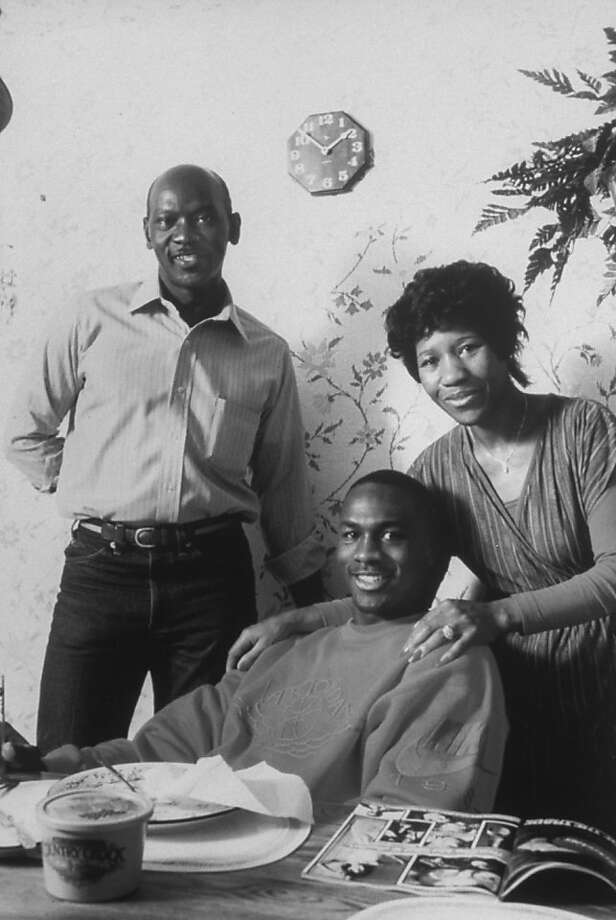 Basketball pro Michael Jordan with his parents James and Deloris in the kitchen of their home; Michael is wearing a Nike Air Jordan sweatshirt. Photo: Buck Miller, Getty Images