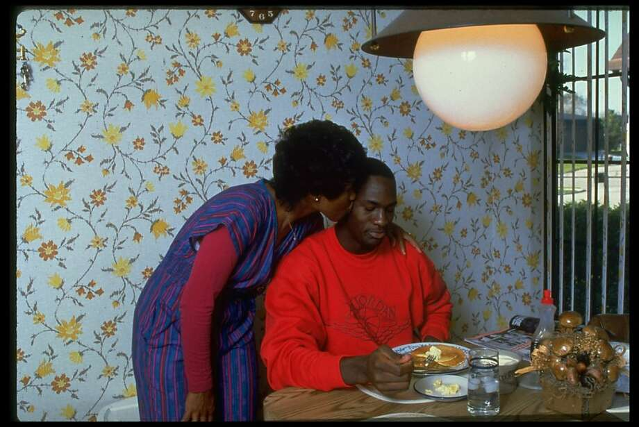 Chicago Bulls basketball star Michael Jordan getting kiss on cheek from his mother, Deloris, while eating stack of pancakes. Photo: Buck Miller, Getty Images