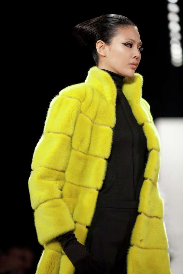 A model walks the runway during the Ralph Rucci Fall 2013 fashion show during Fashion Week, Sunday, Feb. 10, 2013, in New York. (AP Photo/Karly Domb Sadof) Photo: Karly Domb Sadof, Express-News / AP