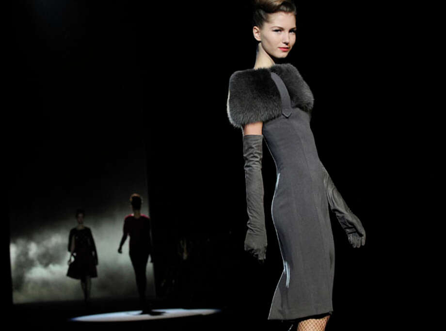 The Badgley Mischka Fall 2013 collection is modeled during Fashion Week, Tuesday, Feb. 12, 2013, in New York. (AP Photo/Louis Lanzano) Photo: Louis Lanzano, Express-News / FR77522 AP