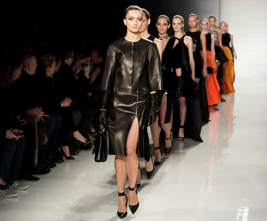 Models wear designs by Michael Kors at the Mercedes-Benz fashion week on February 13, 2013 in New York. AFP PHOTO/DON EMMERTDON EMMERT/AFP/Getty Images Photo: DON EMMERT, Express-News / AFP