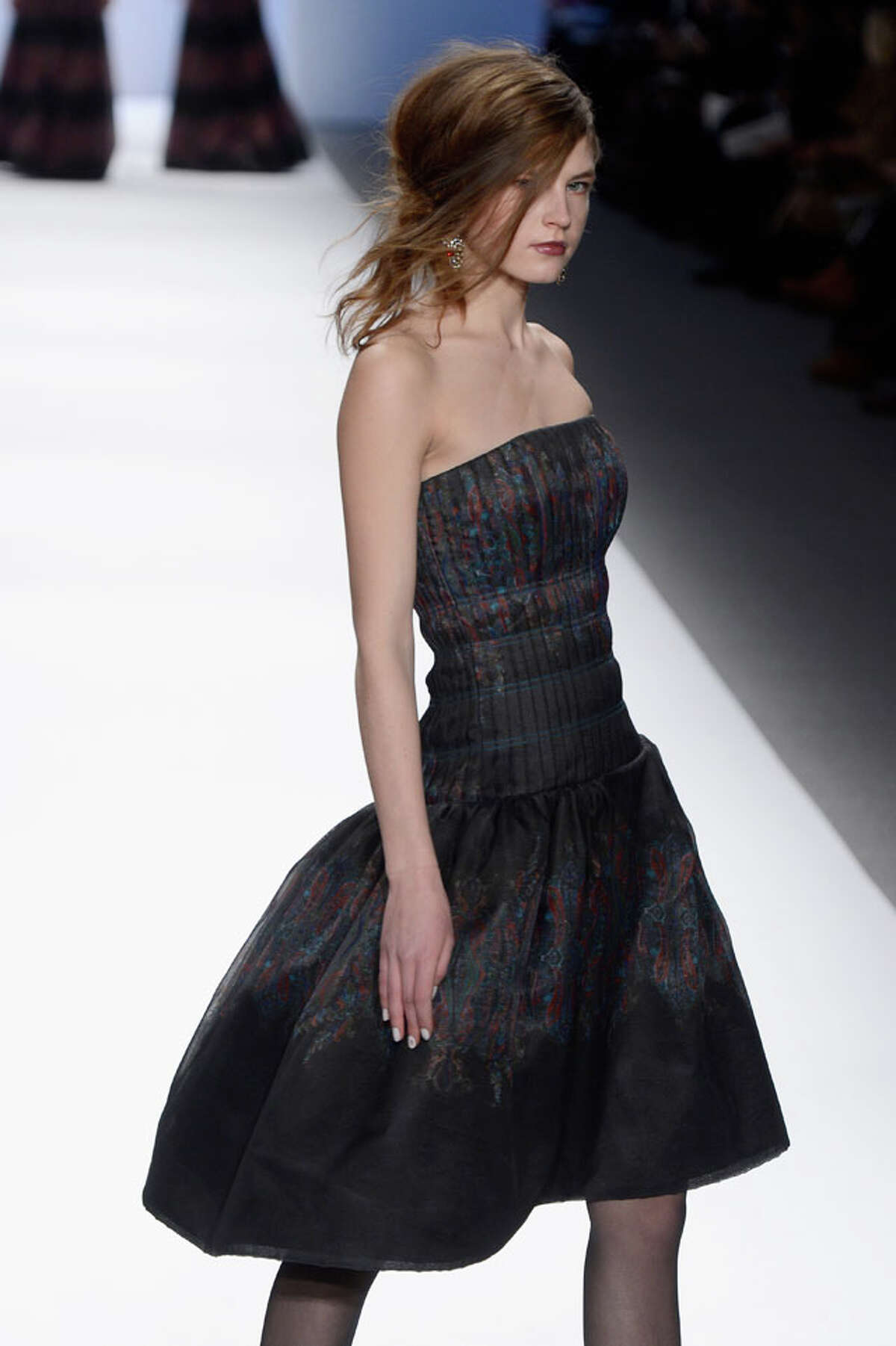 A model walks the runway at the Tadashi Shoji Fall 2013 fashion show during Mercedes-Benz Fashion Week at The Stage at Lincoln Center on February 7, 2013 in New York City. (Photo by Frazer Harrison/Getty Images for Mercedes-Benz Fashion Week)