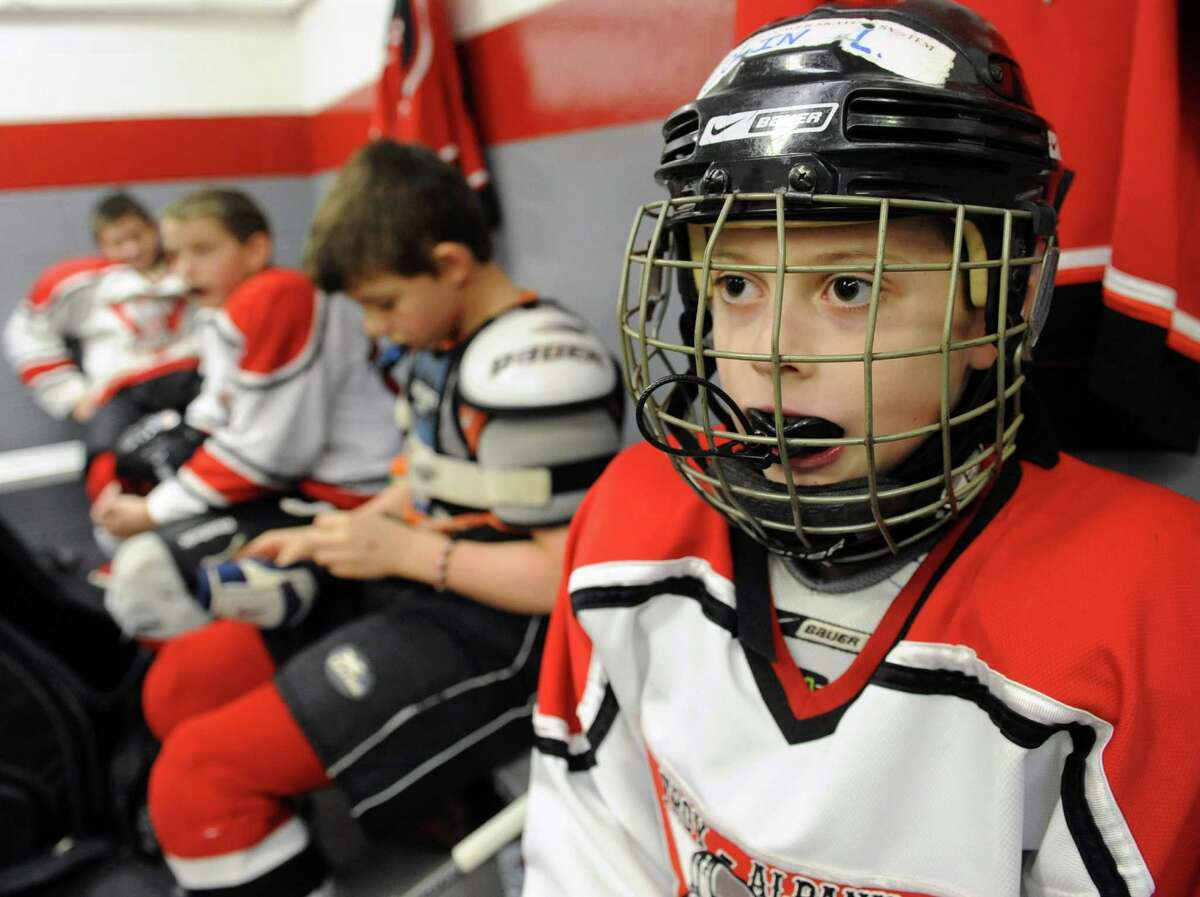 Troy Albany Junior Engineers hockey player Collin Lagios, 11, of Guilderland listens to his coach in the locker room before playing the Yale Bulldogs of Conn. at the 20th annual ?Rink Rat? youth hockey tournament on Friday Feb. 15, 2013 in Troy, N.Y. The tournament consist of teams from 7 states, and 2 provinces including teams from Ottawa, Pittsburgh, Boston, Montreal, Quebec, and Princeton. Events are held at area ice rinks throughout the Capital Region. (Lori Van Buren / Times Union)