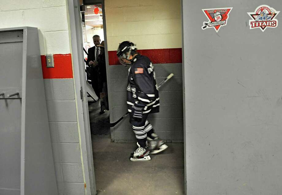 A member of the Yale Bulldogs hockey team of Conn. walks to the rink past the Troy Albany Junior Engineers locker room for a game during the 20th annual ?Rink Rat? youth hockey tournament on Friday Feb. 15, 2013 in Troy, N.Y. The tournament consist of teams from 7 states, and 2 provinces including teams from Ottawa, Pittsburgh, Boston, Montreal, Quebec, and Princeton. Events are held at area ice rinks throughout the Capital Region. This game was held at Frear Park Ice Rink. (Lori Van Buren / Times Union) Photo: Lori Van Buren
