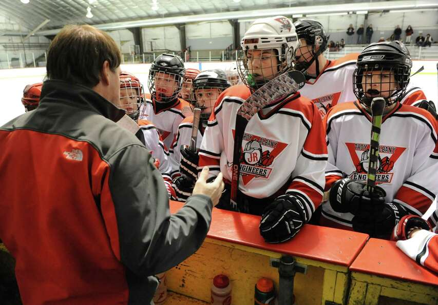 Troy Albany Junior Engineers hockey coach Bill Kennedy talks to his team before playing the Yale Bul