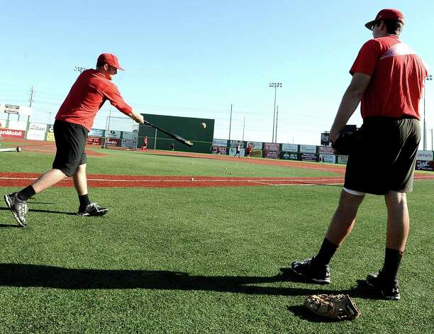 Jerin Spikes, left, hits ground balls during Lamar University baseball practice while Will Hibbs, right, catches in at Vincent-Beck Stadium on Thursday, February 14, 2013. Photo taken: Randy Edwards/The Enterprise