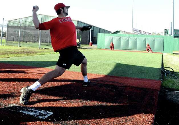 Lamar University baseball player Ben Coram works on his pitching technique during practice at Vincent-Beck Stadium on Thursday, February 14, 2013. Photo taken: Randy Edwards/The Enterprise