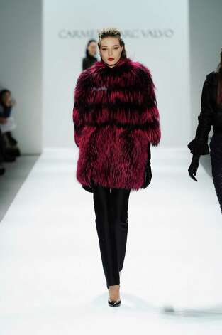 NEW YORK, NY - FEBRUARY 08:  A model walks the runway at the Carmen Marc Valvo Fall 2013 fashion show during Mercedes-Benz Fashion Week Fall 2013 - Official Coverage - Best of Runway Day 2 at Lincoln Center on February 8, 2013 in New York City.  (Photo by Frazer Harrison/Getty Images for Mercedes-Benz Fashion Week) Photo: Frazer Harrison, (Credit Too Long, See Caption) / 2013 Getty Images