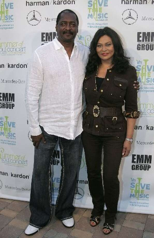 Beyoncé's parents Mathew and Tina Knowles, who divorced after news broke of Mathew Knowles' extramarital affair that produced a son. Shortly after that scandal, Beyoncé fired her father as her manager. (AP photo)