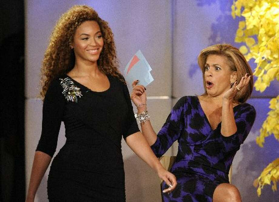 The star surprises Today show co-host Hoda Kotb while modeling one of Tina Knowles' designs. (AP Photo/NBC, Peter Kramer)