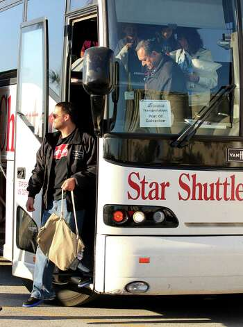 Carnival Triumph cruise ship passengers arrive by bus in Galveston,