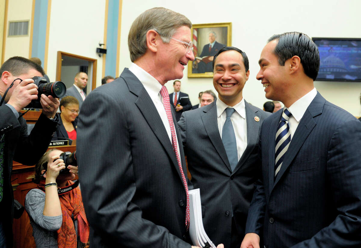 San Antonio Texas Mayor Julian Castro, right, and his brother Rep. Joaquin Castro, D-Texas, center, talk with Rep. Lamar Smith, R-Texas, all from San Antonio, before the beginning of the House Judiciary Committee hearing on America's Immigration System on Capitol Hill in Washington, Tuesday, Feb. 5, 2013. Mayor Castro was one of the witnesses.(AP Photo/Susan Walsh)