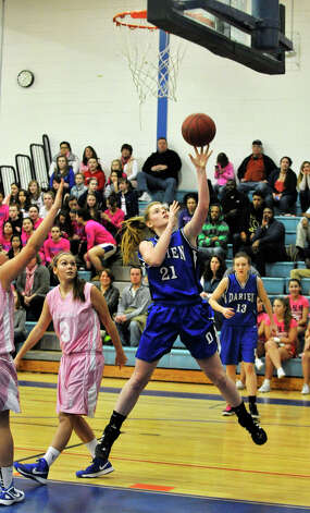 Darien's Meg Marren lays the ball in uncontested during their game against Danbury at Danbury High School on Tuesday, Jan. 29, 2013. Danbury won, 51-44. Photo: Jason Rearick / The News-Times