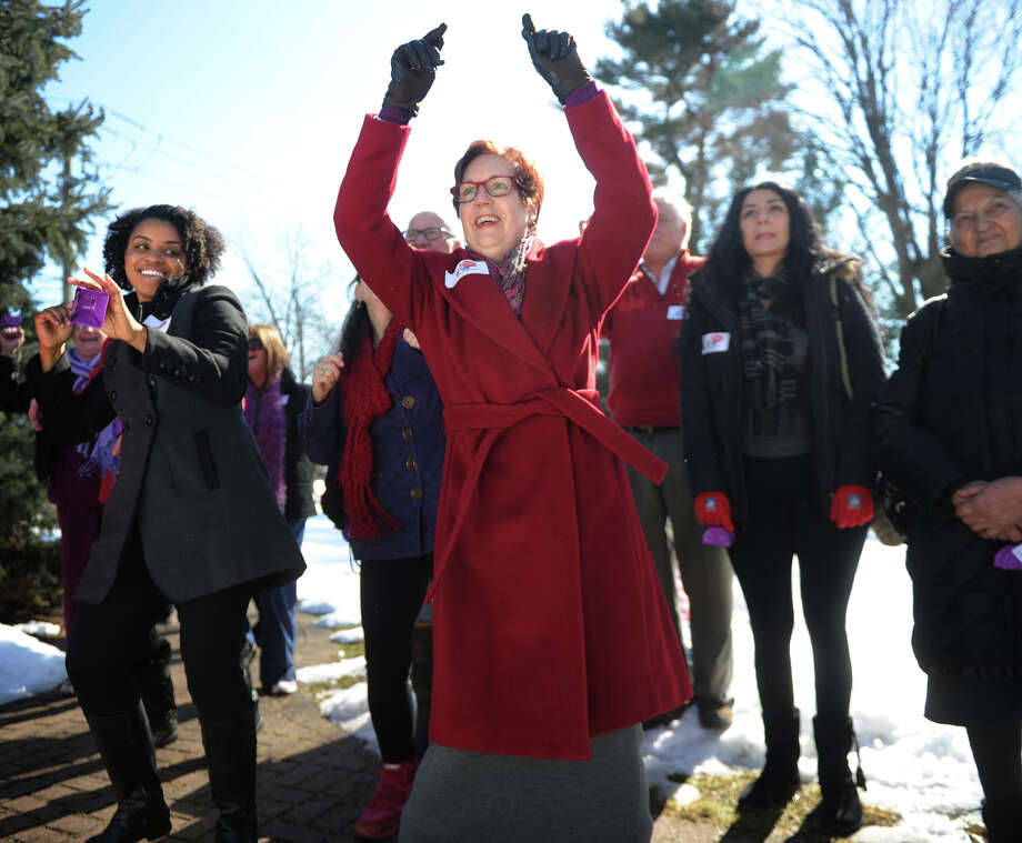 H'Vanna Samuels, left of Bridgeport, and DVCC counselor Nancy Berkowitz, dance in support of One Billion Rising, a global movement to end violence against women and girls, during a rally on The Green in Norwalk on Thursday, February 14, 2013. Photo: Brian A. Pounds / Connecticut Post