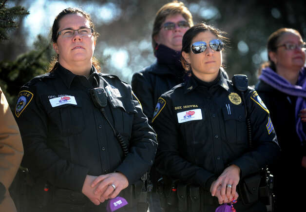 Darien police Off. Elizabeth DiIorio, left, and Sgt. Alison Hudyma attend a rally in support of One Billion Rising, a global movement to end violence against women and girls, on The Green in Norwalk on Thursday, February 14, 2013. Photo: Brian A. Pounds / Connecticut Post