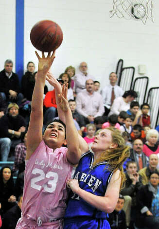 Danbury's Kayla Handberry shoots while under pressure from Darien's Meg Marren during their game at Danbury High School on Tuesday, Jan. 29, 2013. Danbury won, 51-44. Photo: Jason Rearick / The News-Times