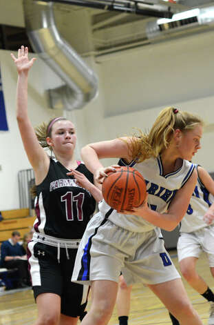 Darien's Meg Marren (21) boxes out as Farmington's Ally Walsh (11) defends during the girls basketball game at Darien High School on Tuesday, Feb. 28, 2012. Photo: Amy Mortensen