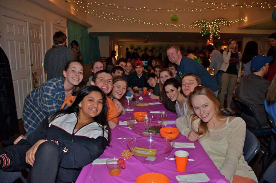 Members of the Congregational Church of New Canaan's youth group enjoy their send-off dinner Thursday, Feb. 14, 2013, before leaving on their mission trip to Toa Alta, Puerto Rico. Photo by Jeanna Petersen Shepard Photo: Freelance Photo
