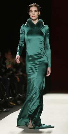 Carolina Herrera brought understated shimmer in evergreen to the  New York fall shows. Photo: Associated Press Photos