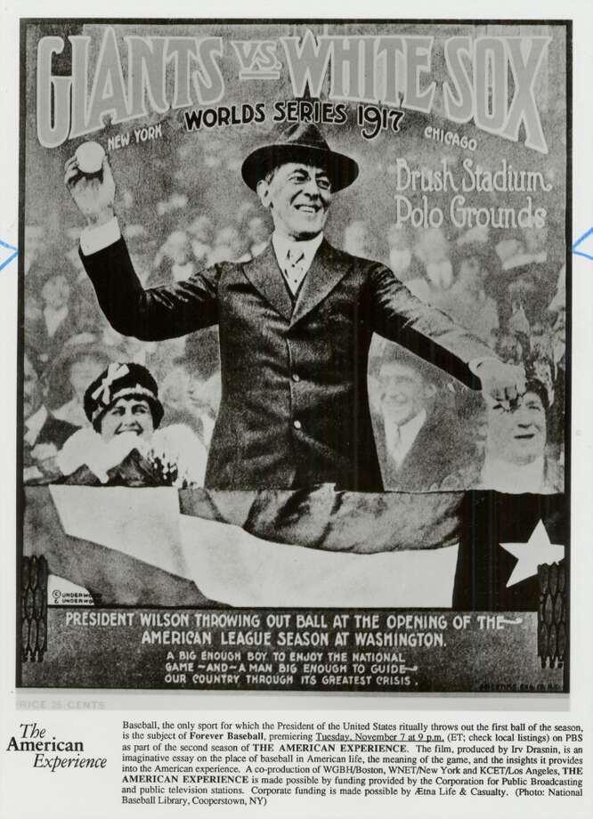 This poster was made to commemorate the moment. Notice the bemused ladies behind President Wilson. Photo: SFC