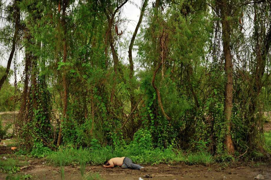 "Photojournalist Fernando Brito's images, on display in ""Cronicas"" at FotoFest through March 9, put corpses into the context of the landscape where they were found. Photo: Fernando Brito"