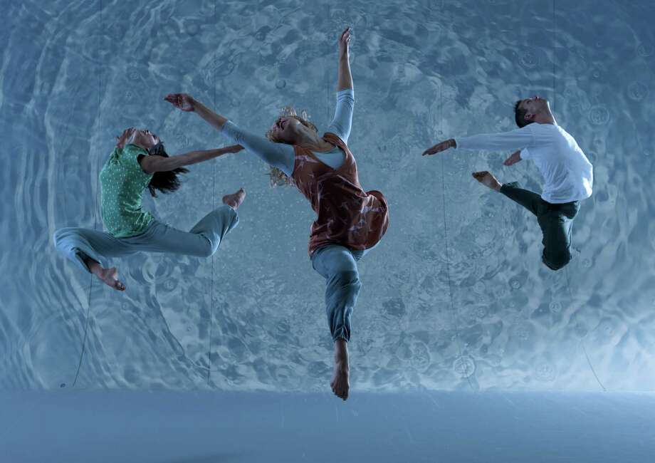 """Members of Motionhouse perform in """"Scattered,"""" a show that blends dance, film and music to explore a theme about water. Society for the Performing Arts presents the company in its Houston premiere at 8 p.m. Friday at the Wortham Theater Center. Photo: Chris Nash"""