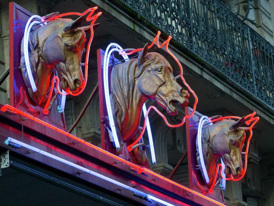 3 statues of horses' heads,  above a horsemeat butcher shop  in Paris, Friday Feb 15, 2013.  Tests have found horsemeat in school meals, hospital food and restaurant dishes in Britain, officials said Friday, as the scandal over adulterated meat spread beyond frozen supermarket products. French French Consumer Affairs Minister Benoit Hamon said Thursday that it appeared fraudulent meat sales over several months reached across 13 countries and 28 companies. He identified French meat wholesaler Spanghero as a major culprit. (AP Photo/Jacques Brinon) Photo: Jacques Brinon, STF / AP