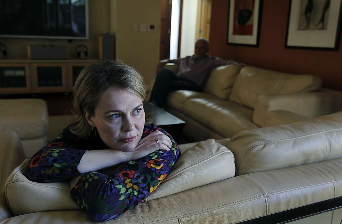 Jeannette Burmeister sits in the living room with her husband Ed (background) in Menlo Park, Calif. on Friday, Feb. 15, 2013. Jeannette Burmeister suffers from a type of chronic fatigue and spends have of the week at Incline Village near Lake Tahoe to receive treatments of an experimental drug that was recently rejected by the FDA.