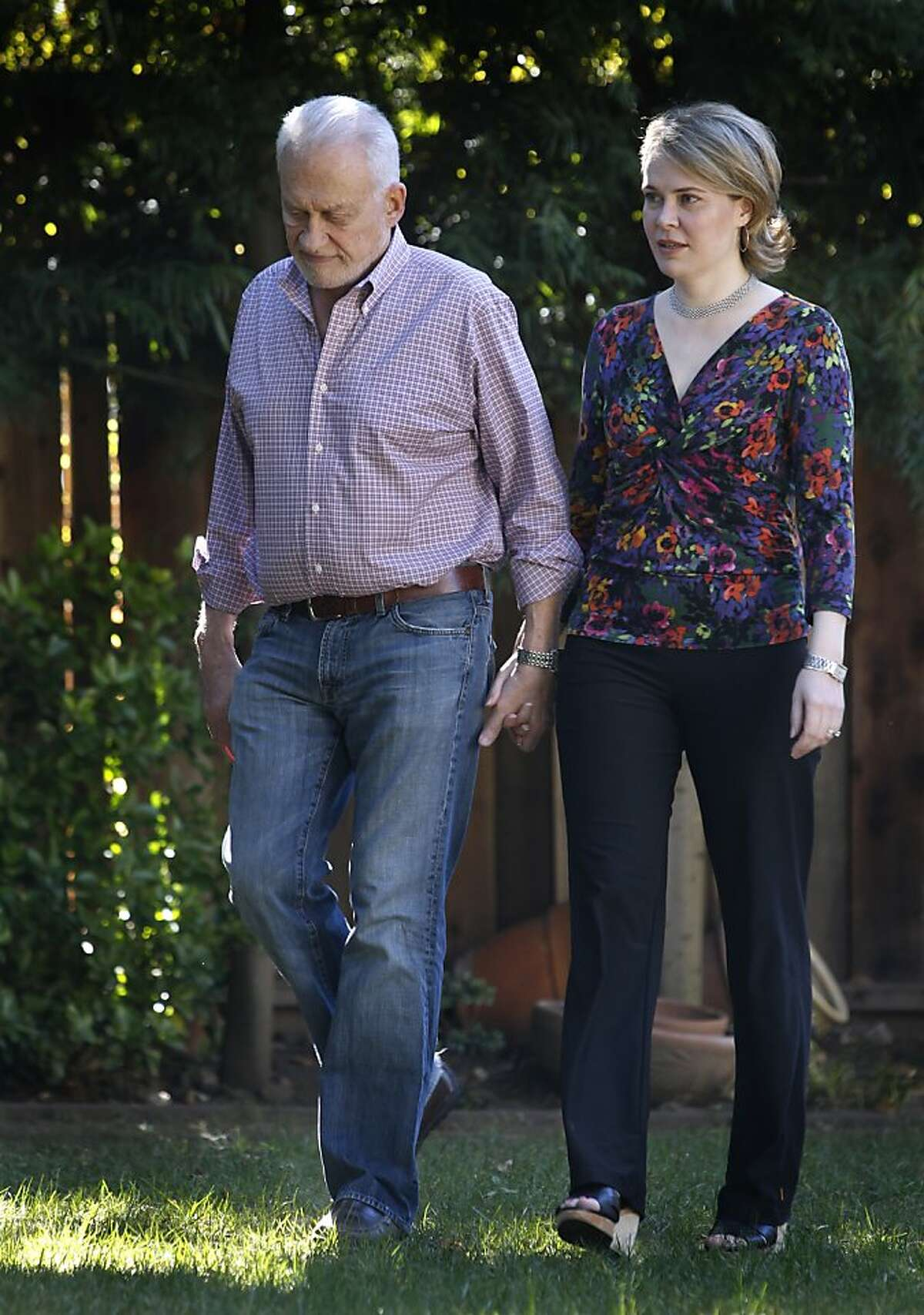 Jeannette Burmeister and her husband Ed take a walk in the backyard of their home in Menlo Park, Calif. on Friday, Feb. 15, 2013. Jeannette Burmeister suffers from a type of chronic fatigue and spends have of the week at Incline Village near Lake Tahoe to receive treatments of an experimental drug that was recently rejected by the FDA.