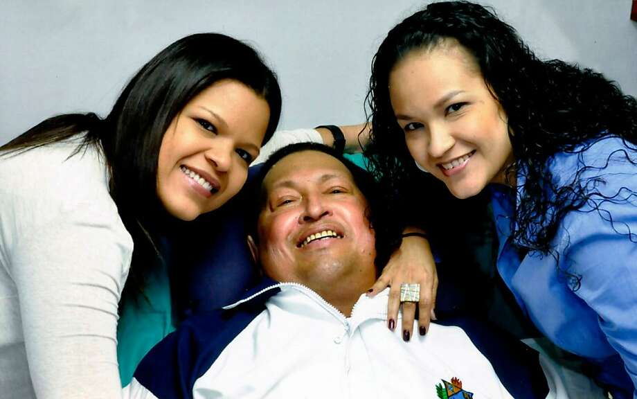 Hugo Chavez, photographed with daughters Maria Gabriela (left) and Rosa Virginia in Havana. Photo: Associated Press