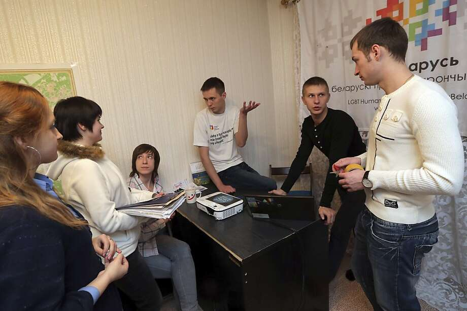 GayBelarus leader Siarhei Androsenka (center) and his friends tried to legally register the rights organization. Photo: Sergei Grits, Associated Press