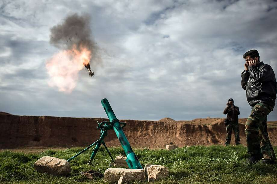 Syrian rebels fire a mortar towards regime forces stationed at Kwiriss airport in Al-Bab, 30 kilometres from the northeastern Syrian city of Aleppo, on February 14, 2013. Syrian Foreign Minister Walid al-Muallem and opposition National Coalition chief Ahmed Moaz al-Khatib will make separate visits to Moscow for talks in the coming weeks, a top Russian diplomat said. Photo: Elias Edouard, AFP/Getty Images
