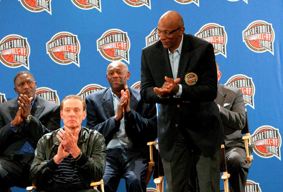 Basketball Hall of Famer Clyde Drexler, right, claps during a press conference announcing the 2013 Hall of Fame finalists. Photo: Cody Duty, Houston Chronicle / © 2013 Houston Chronicle