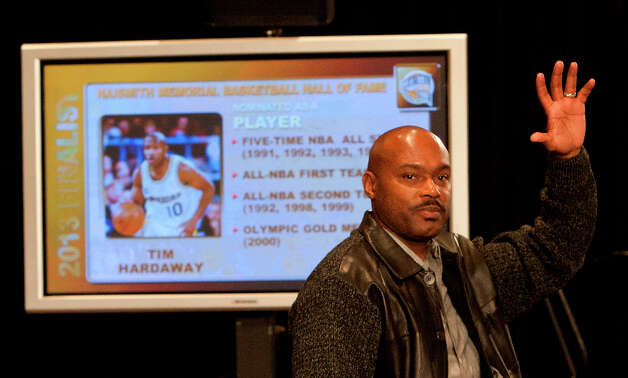 Basketball Hall of Fame finalist Tim Hardaway waves during a press conference. Photo: Cody Duty, Houston Chronicle / © 2013 Houston Chronicle
