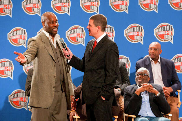 Basketball Hall of Fame finalist Gary Payton, left, is interviewed during a press conference announcing the 2013 Hall of Fame finalists. Photo: Cody Duty, Houston Chronicle / © 2013 Houston Chronicle